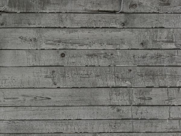 Rustic grey planks set horizontally with water marks.