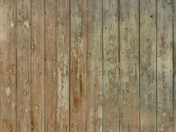 Rustic vertical planks with peeling paint.