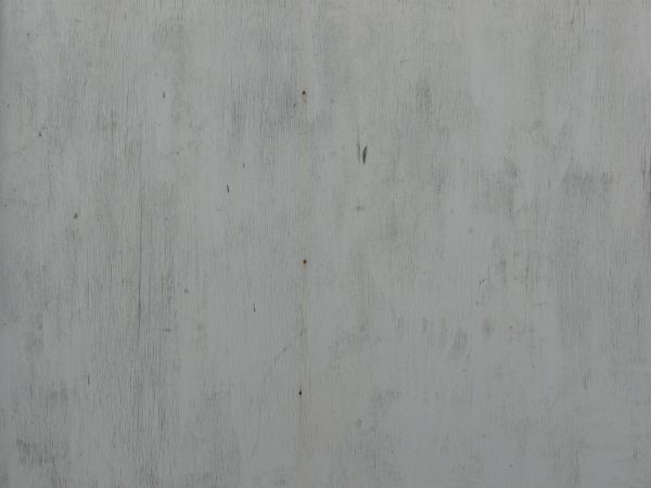 White Wood Texture Covered By An Even Layer Of Paint. Small Vertical Cracks  And A